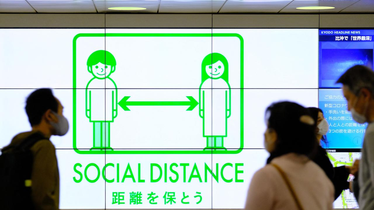 Masks and social distancing could be needed well into 2022 amid the threat of new virus strains. Picture: Kazuhiro Nogi/AFP