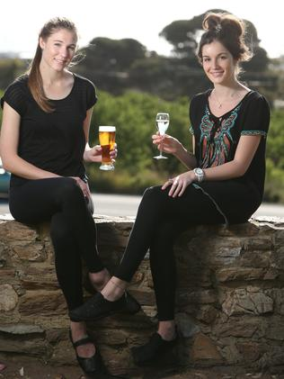 Friends Emma Raper and Rachel Lippett soak up the sun at Victory Hotel earlier this year. Picture: Tait Schmaal