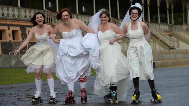 5/7/14 - (L-R) Skating Brides Jodie Butcher of Woodcroft, Nicole Lahiff of Onkaparinga Hills, Sue Pomeroy of Clovelly Park, Kim Harvey of Eden Hills, Merridy Brown of Glengowrie, Kris Hayres of Everard Park, Emmy Bauer of Seacliff Park and Kerryn Brownson of Norwood at Victoria Park - Roller skating aficionados will morph into roller skating brides as they dress up for a charity event on wheels. The event, in October, will raise money for Beyondblue and will see skaters - dressed in wedding gowns - take to a track around Victoria Park. Photo Naomi Jellicoe