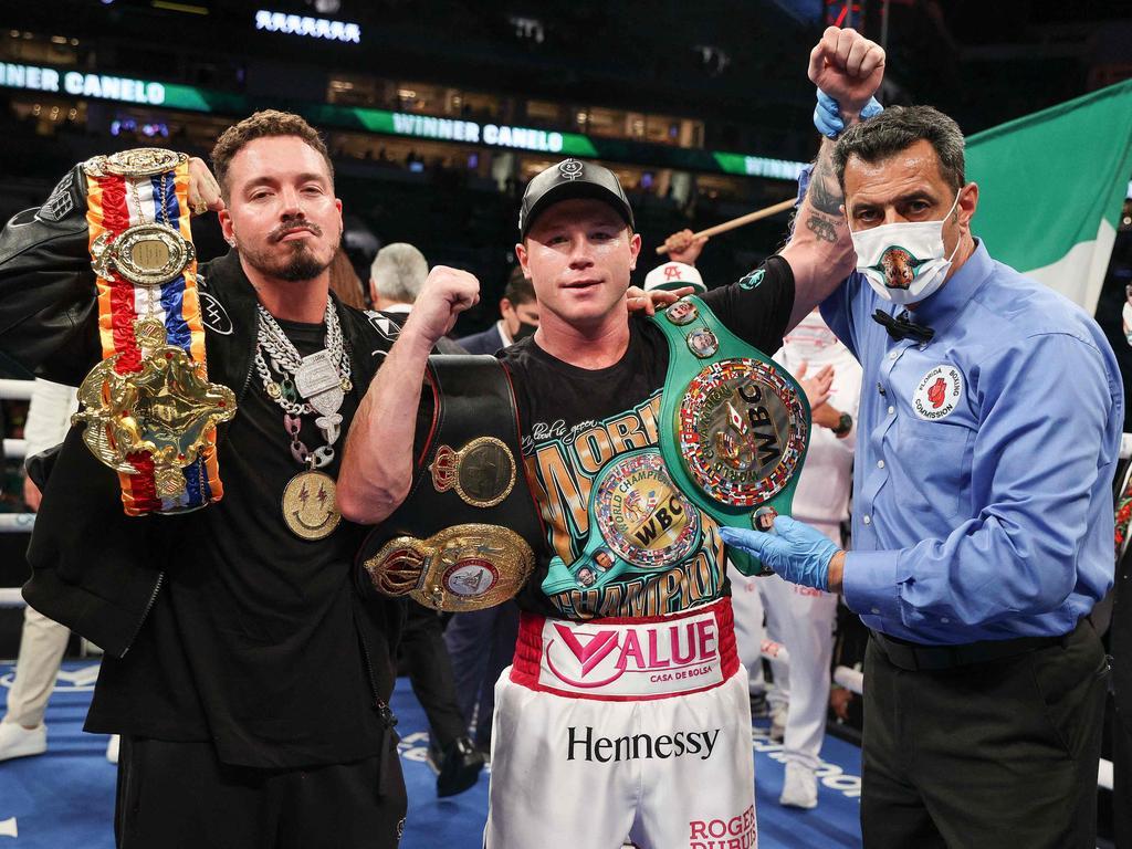 Saul Alvarez celebrates retaining his WBA, WBC and Ring Magazine super middleweight titles. (Photo by Ed Mulholland / Matchroom Boxing / AFP)