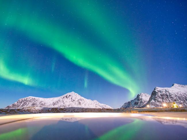 "MOSKENESÖYA, NORWAY ""It was an 8-hour drive from Tromso to Lofoten. It was in the middle of the night and suddenly I discovered the Northern Lights. Since I had no tripod at hand, I used the car roof!"" – @and1402"