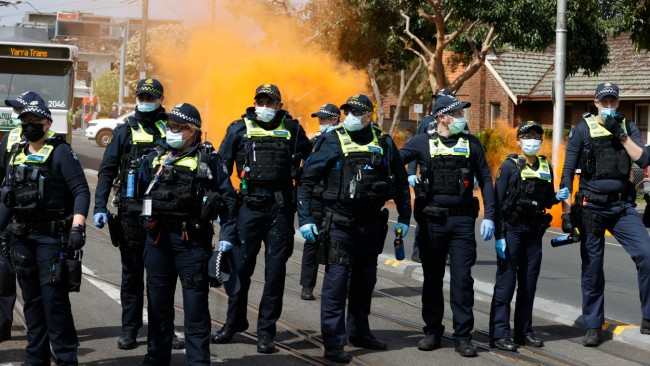 An anti-lockdown protest in Melbourne on September 18. Police deal with protesters on Bridge Rd, Richmond. Picture: NCA