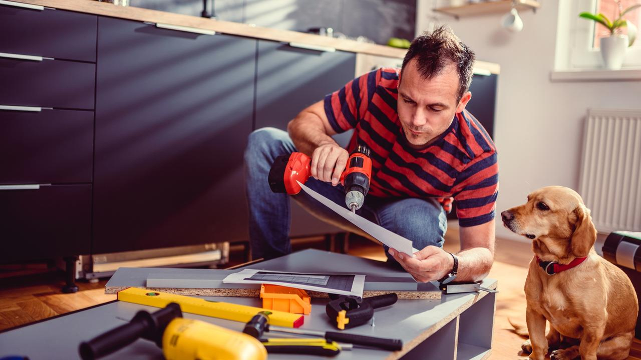 Attach new handles to cupboard doors or paint the kitchen bench, but be realistic about what you can do with your skill set. Picture: iStock