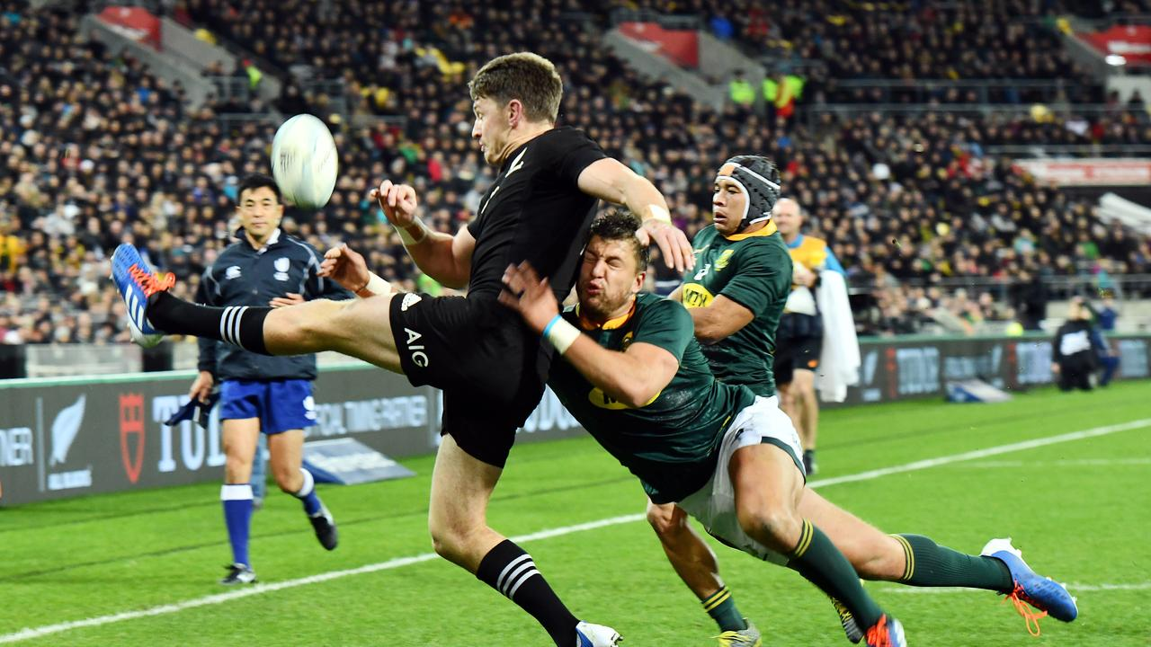Beauden Barrett clears under pressure from while Handre Pollard. Picture: Getty