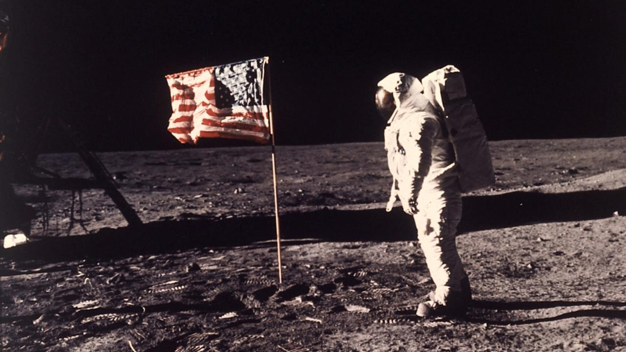 """FILE - This July 20, 1969 file photo released by NASA shows astronaut Edwin E. """"Buzz"""" Aldrin Jr. posing for a photograph beside the U.S. flag deployed on the moon during the Apollo 11 mission. The family of Neil Armstrong, the first man to walk on the moon, says he has died at age 82. A statement from the family says he died following complications resulting from cardiovascular procedures. It doesn't say where he died. Armstrong commanded the Apollo 11 spacecraft that landed on the moon July 20, 1969. He radioed back to Earth the historic news of """"one giant leap for mankind."""" Armstrong and fellow astronaut Edwin """"Buzz"""" Aldrin spent nearly three hours walking on the moon, collecting samples, conducting experiments and taking photographs. In all, 12 Americans walked on the moon from 1969 to 1972. (AP Photo/NASA, Neil A. Armstrong, file)"""