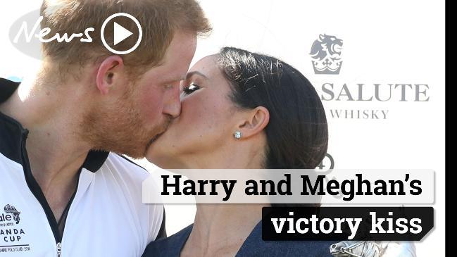 Harry and Meghan's victory kiss
