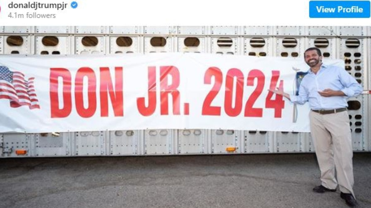 Donald Trump Jr with a banner made by a fan for his potential candidacy next time around. Picture: Instagram