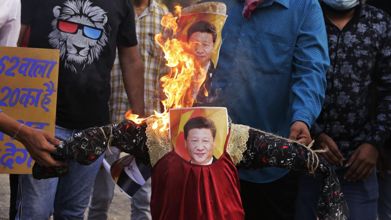 As well as being accused of launching technological wars in Australia, China has started a physical attack in India, killing 20 Indian troops yesterday. This picture shows Indians burning an effigy of Chinese President Xi Jinping after the attack Picture: Ajit Solanki/AP