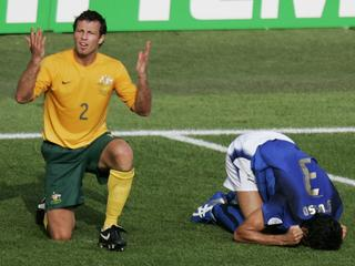20/12/2006 LIBRARY: Australian soccer player Lucas Neill (2) reacts after he tackled Italian Fabio Grosso in the penalty box during the last minutes of the Australia Socceroos v Italy World Cup soccer match at Fritz Walter Stadium in Kaiserslautern, Germany, 26 Jun 2006. Italy was awarded a penalty and won the match.