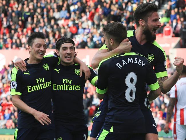 Arsenal's French striker Olivier Giroud (R) celebrates with teammates.