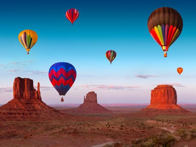 54. HOT AIR BALLOON OVER UTAH'S MONUMENT VALLEY The striking landscape of Monument Valley in America's Wild West boasts an embarrassing amount of natural wonders - deep gorges, stunning rock formations, windswept tablelands, and of course, the iconic uniquely-shaped sandstone buttes. Sure, you can hike here, but floating above at sunrise or sunset is magical.