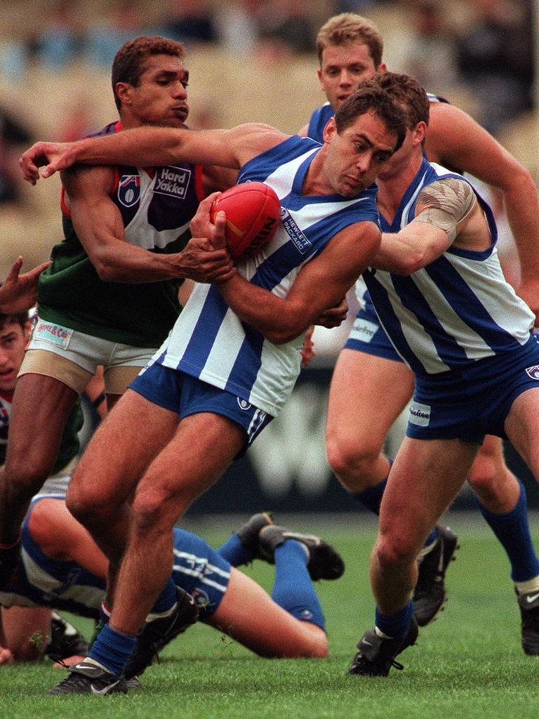 Over his star career, Wayne Schwass played 282 games for North Melbourne and the Sydney Swans.