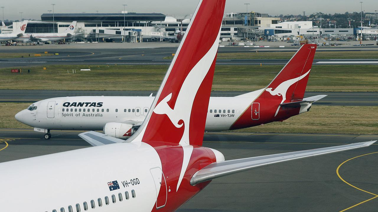 The new streamlined kangaroo logo adorns the tail of a Qantas Boeing 767 (front) as a Qantas Boeing 737 (back) featuring the now superceded logo taxis past during the official unveiling of the new Qantas livery at Sydney Airport, 24 July 2007. The original kangaroo symbol, adapted from the Australian one penny coin, was first painted beneath the cockpit of a Qantas Airways Liberator aircraft in 1944 before wings were added in a 1947 redesign.  AFP PHOTO/Torsten BLACKWOOD