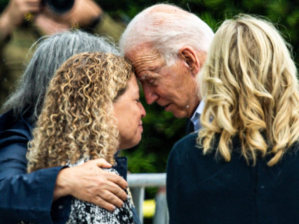 US President Joe Biden and US First Lady Jill Biden meet Miami Dade County Mayor Daniella Levine Cava as they visit a photo wall, the 'Surfside Wall of Hope & Memorial', near the partially collapsed 12-story Champlain Towers South. (Photo by CHANDAN KHANNA / AFP)