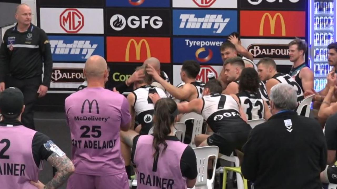 Port Adelaide players congratulate Todd Marshall for his hard work in the rooms post-game, after being called out by Ken Hinkley.