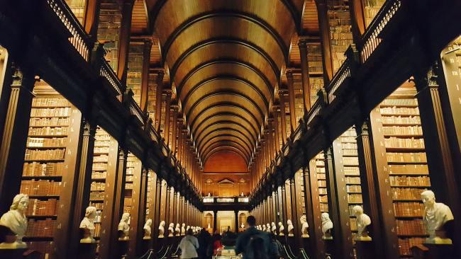 4/34Trinity College Library, Dublin Ireland Established in 1592, this historical library goes back to the founding of Trinity College. Two of the four volumes of the Book of Kells are housed here on public display. It might look like it could be Hogwarts, but Harry Potter was not filmed here. Picture: Naomi Hutchinson / Unsplash