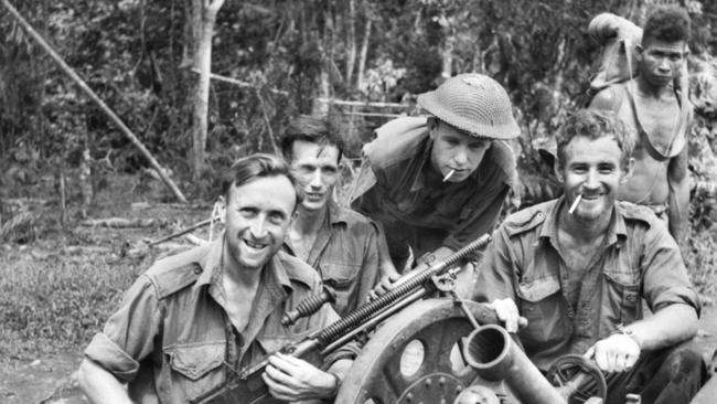 Australian soldiers with a captured Japanese mountain gun which was taken at bayonet point. Pictures: AAP/Australian War Memorial