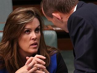 PM Tony Abbott confers with his chief of staff Peta Credlin during Question Time today in the House of Representatives, Feder...