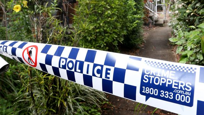 Police tape at a unit block at Kidston St where a man was badly assaulted. PICTURE: ANNA ROGERS