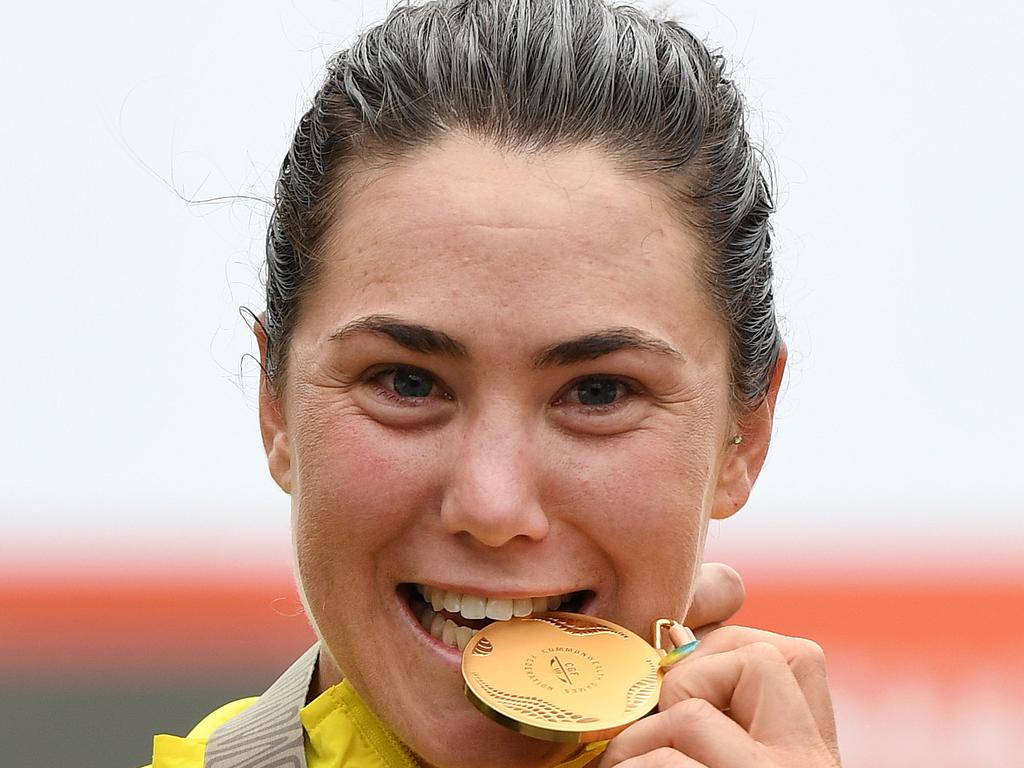 Chloe Hosking of Australia celebrates her gold medal in the women's cycling road race on day ten of the XXI Commonwealth Games on the Gold Coast, Australia, Saturday, April 14, 2018. (AAP Image/Dan Peled) NO ARCHIVING, EDITORIAL USE ONLY