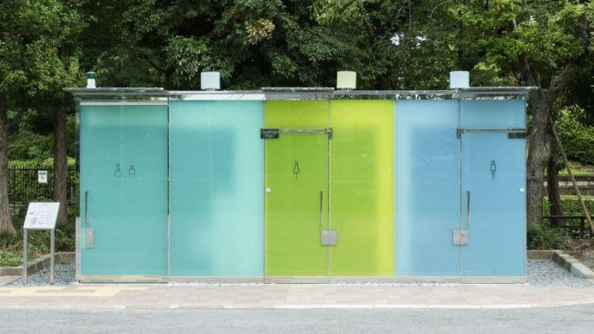 The coloured-glass washrooms are cleverly designed to be transparent when unoccupied — so potential users can confirm they're empty and clean — but turn opaque once the door is locked internally. (Satoshi Nagare // The Nippon Foundation)