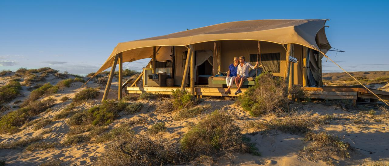 ESCAPE:  Couple relaxing at their accommodation, Sal Salis Ningaloo Reef. Picture: Tourism Western Australia