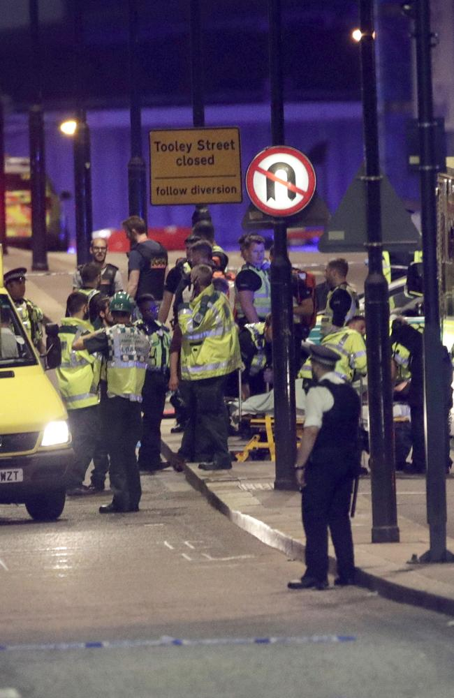Emergency personnel tend to wounded on London Bridge. Picture: AP