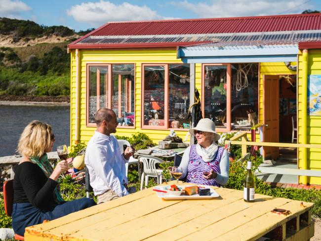 Eat at the Restaurant with no Food Fancy a romantic waterside dinner, where the waiters definitely won't be intrusive? Book a table at the Boathouse, AKA the Restaurant with No Food. In an idyllic setting overlooking crayfish boats on King Island's Currie Harbour, it's quirky, colourful, and set up just like a restaurant, but with no chef, no waiters, and no food. You take your own. A hamper of King Island gourmet produce will do the trick nicely. The Boathouse - The Restaurant With No Food. Credit: Stu Gibson