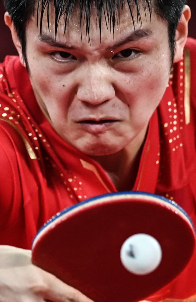 China's Fan Zhendong was a picture of total concentration during the men's semi final table tennis match. Picture: Jung Yeon-je / AFP