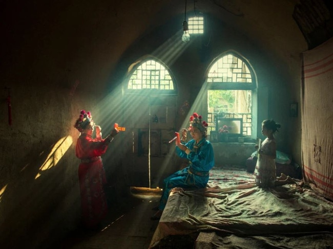 FIRST PLACE, PEOPLE Actors prepare for an evening opera performance in Licheng County, China. The photographer spent the whole day with these actors from make-up to stage. Picture: Huaifeng Li/National Geographic Travel Photo Contest