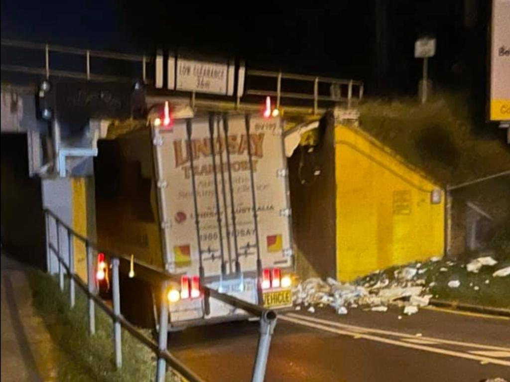 A truck was stuck under the Oxley Road railway bridge this morning in Corinda.