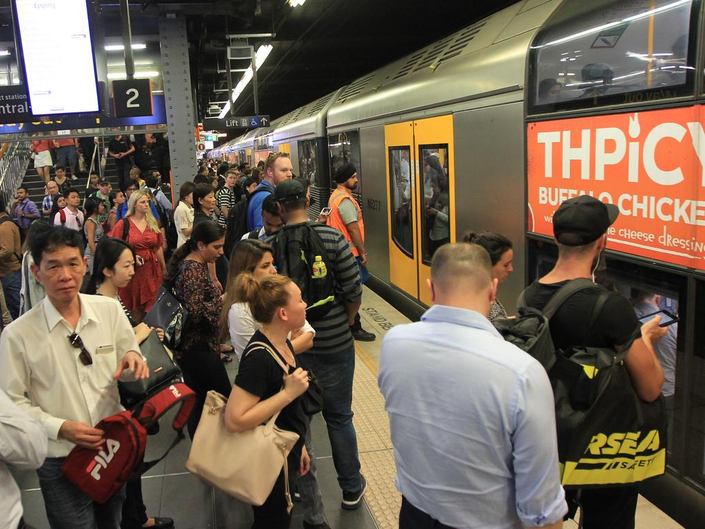 Pictured is a crowded platform at Town Hall train station tonight with temperatures reaching up to 32 degrees. Picture: Christian Gilles