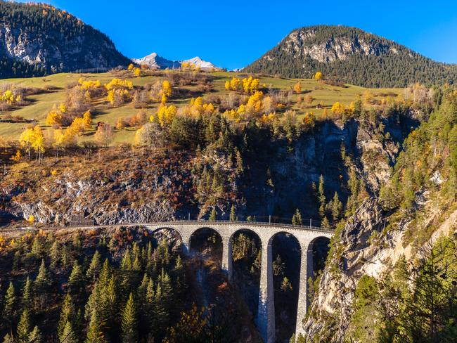 1. TRAVEL SWITZERLAND BY SCENIC RAIL Alpine scenery and charming villages abound on a Swiss rail journey that crisscrosses the countryside. Look out for notable places like the Bernina Pass, the Matterhorn, Chapen Bridge and the famous Landwasser Viaduct (pictured).
