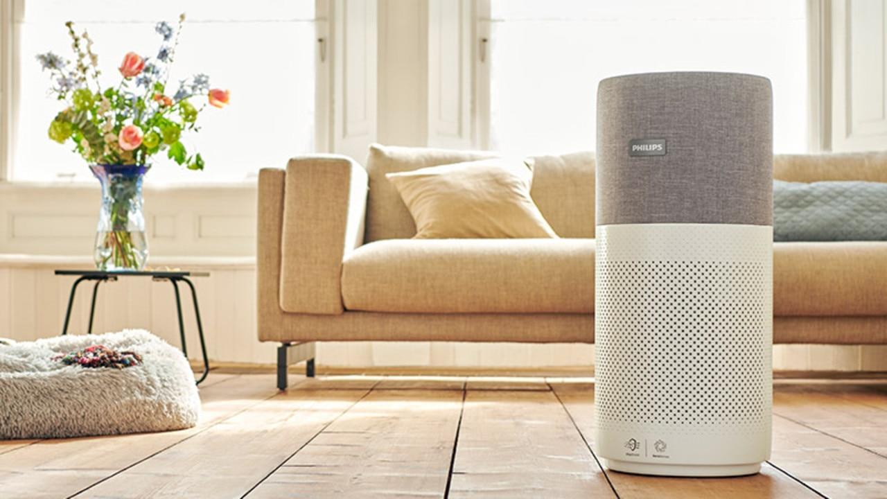 An air purifier can help you breathe easier at home by eliminating harmful and irritating pollutants from pet dander and pollen to gases and odours. Image: Philips.