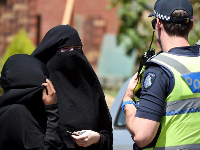 Police speak with two women at the scene of a raid in Meadow Heights. Picture: Nicole Garmston