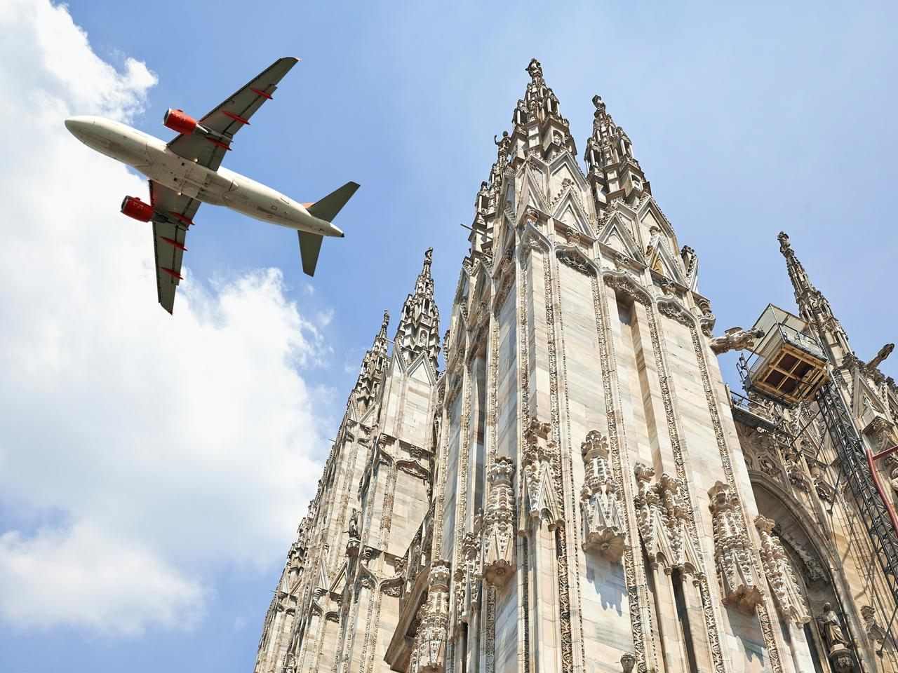 Jet plane flying low over the Milan Cathedral