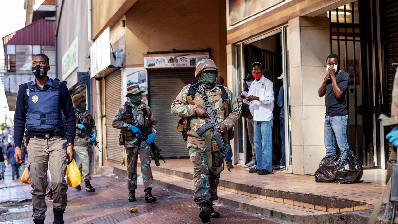South Africa has seen murders and car accidents fall amid one of the world's strictest lockdowns. South African soldiers patrol in the streets of Hillbrow, Johannesburg during lockdown. Picture: Michele Spatari/AFP.