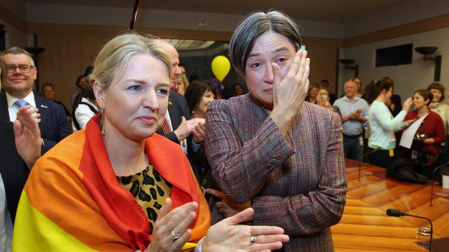 Labor Senator Louise Pratt (left) with an emotional Penny Wong when the same-sex marriage vote was revealed. Picture Gary Ramage