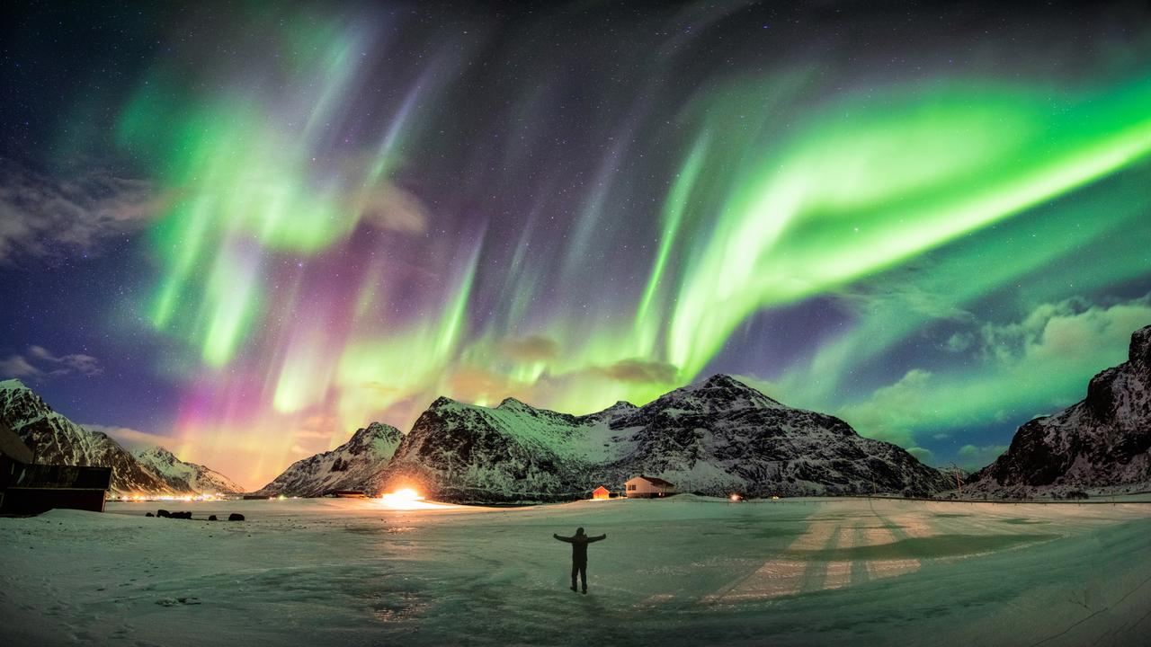 The ideal viewing conditions for the Northern Lights are darkness and clear skies.