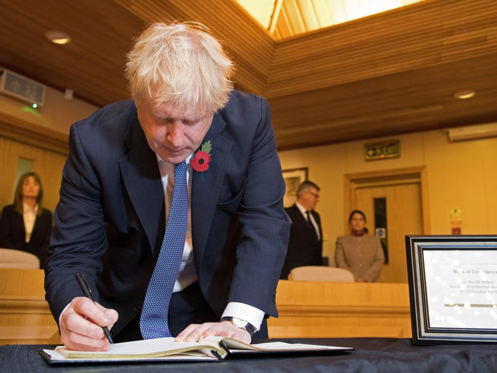Britain's Prime Minister Boris Johnson signs a book of condolence during a visit to Thurrock Council Offices in Thurrock. Picture: Stefan Rousseau/AFP