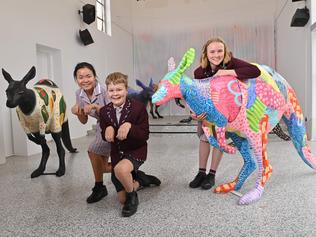 "5/2/2021. St John's Grammar School commissioned SA artists to be involved with the ""Trooper Project"", where designer Kangaroo's will be auction off to raise money for the 2020 bushfire animals on KI. (The Glossy Black Cockatoo's project and Kangala Rescue). Students  Jiayi - 18 , Eddie - 13yrs and Millie - 15 yrs.  Picture: Keryn Stevens"