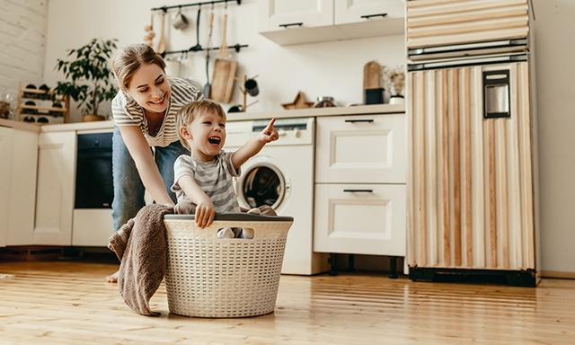 mum playing with child in laundry