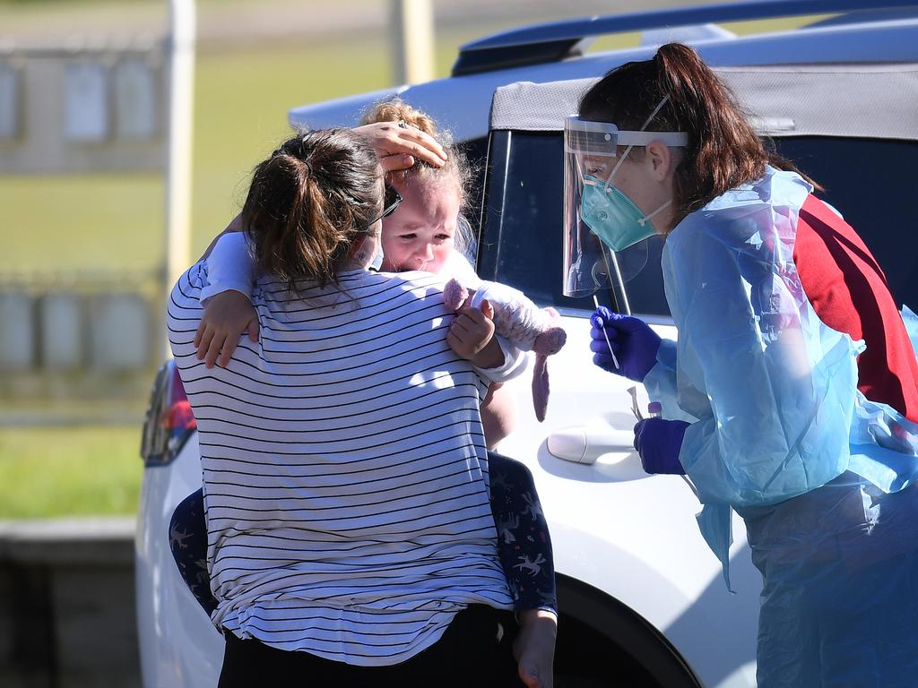 A health worker attempts to swab an unhappy toddler at a pop up Covid-19 testing clinic in Toowong, Brisbane, as Queensland battles through a Delta variant outbreak of coronavirus.  Picture: NCA NewsWire / Dan Peled