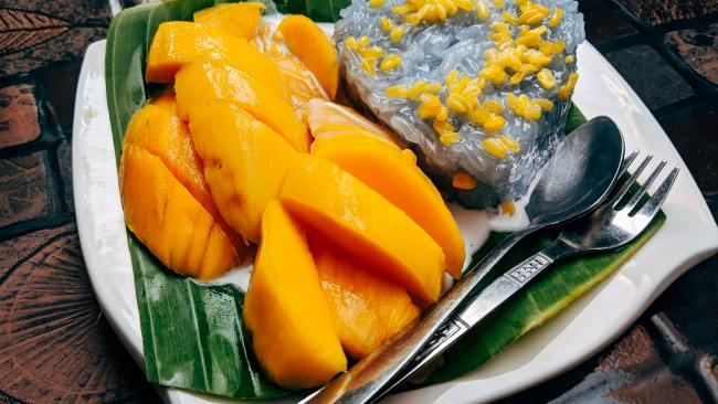 Mango sticky rice/Khao Niaow Ma Muang - Thailand Ripe mangos, rich coconut milk, sugar and glutinous rice are the key ingredients for this fresh dessert. Found all over Thailand at street stalls (for around $3-4)  and restaurants during summer as a welcome chaser to a savoury main course. Picture: Markus Winkler / Unsplash