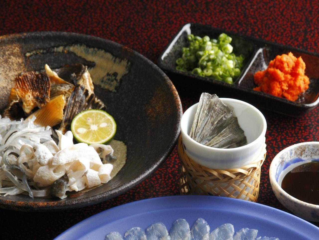Wakasa blowfish or fugu thin fillet in big platter with