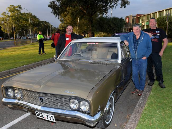 Holden fans with an HG Premier outside the plant. Picture: AAP