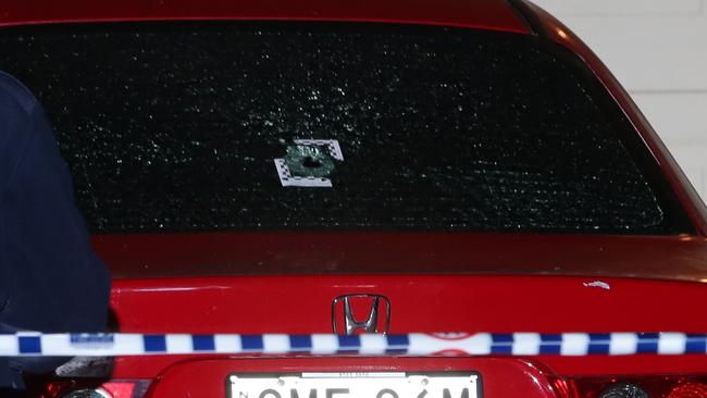One of the bullet holes was clearly visible in one of the car windows. Picture: Bill Hearne