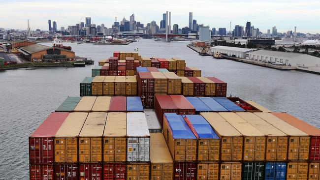 A container ship arrives in Melbourne. It's not known which ship was responsible for the loud blasts.