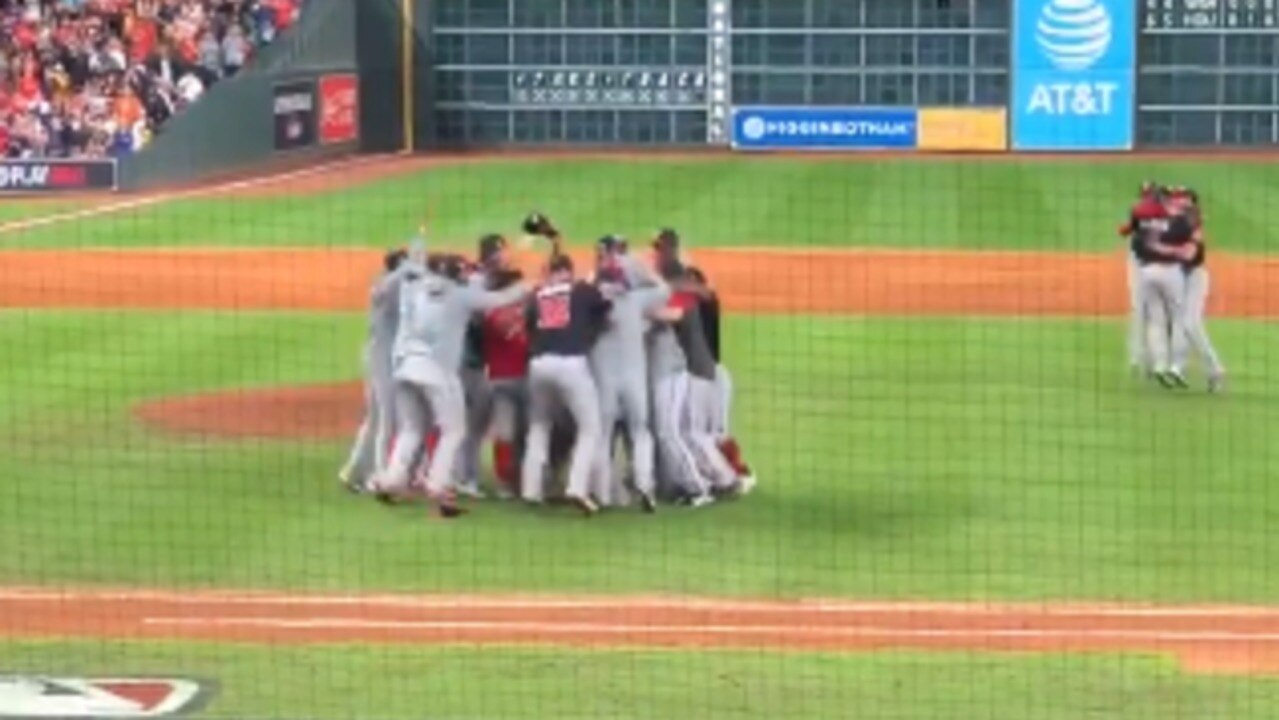 Nationals Players Storm Field to Celebrate World Series Title