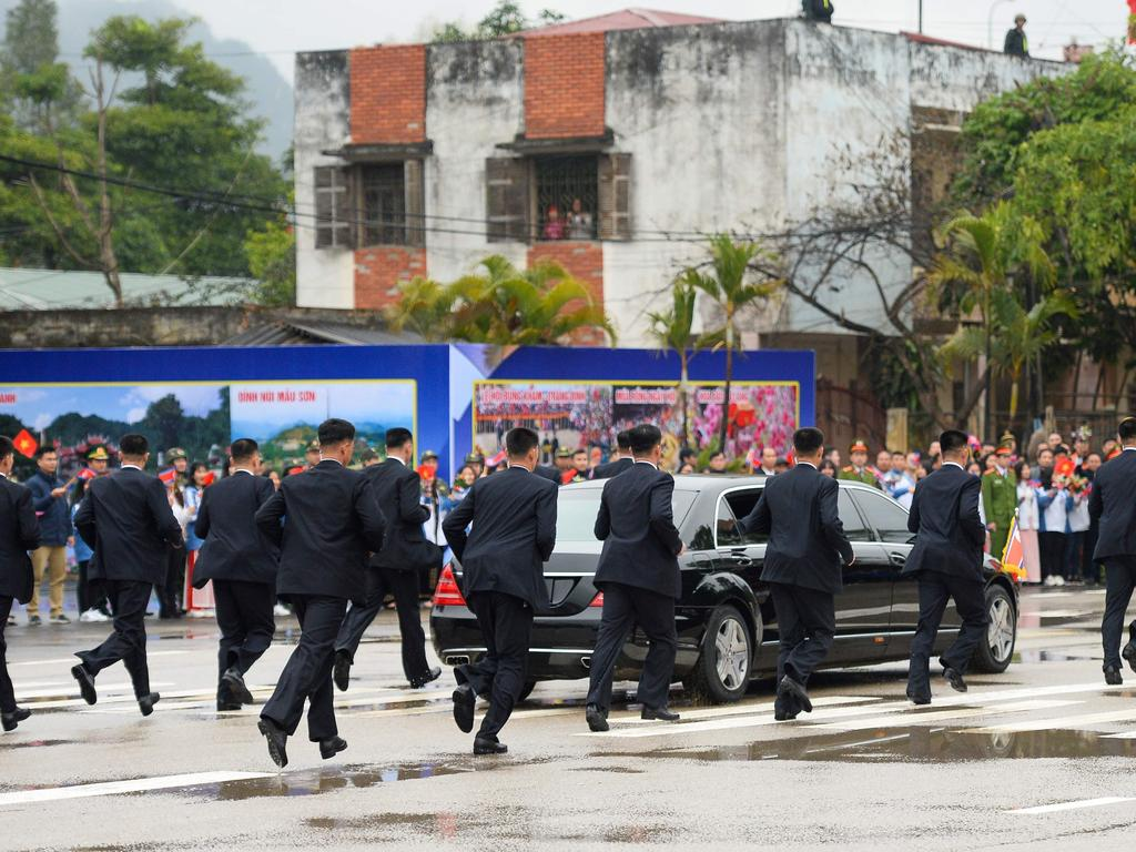 Kim Jong Un's bodyguards run alongside his car as he leaves Dong Dang railway stationon the Vietnamese border, to attend the second US-North Korea summit in Hanoi. Picture: Nhac Nguyen / AFP